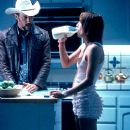 Jon Gries as Sunny Holiday and Camellia Clouse as Tangerine in Sony Pictures Classics' Jackpot - 2001