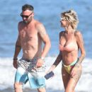 Tina Louise in a bikini with Brian Austin Green at the beach in Los Angeles - 454 x 641