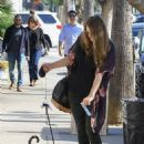 Kayla Tabish takes her Bengal cat for a walk in Studio City