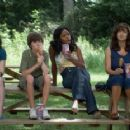 Tabby (Ashley Duggan Smith), Little Pete (Christopher Newhouse), Imogene (Jill Marie Jones), and Anora (Laura Harring) eat corn dogs in the scene of Drool. - 454 x 232