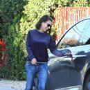 Mila Kunis–Heads out to her car in LA