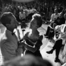 Luis Miguel Dominguin standing at mike with Mary Martin during Hilton Hotel opening Jul 01, 1953