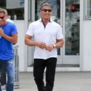 Sylvester Stallone goes for a stroll with friends in Beverly Hills on April 6, 2016 - 454 x 590