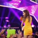 Ariana Grande accepts the Favorite TV Actress award onstage from actor Chris Rock and daughter Zahra onstage during Nickelodeon's 27th Annual Kids' Choice Awards