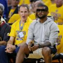 Singer and Cleveland Cavaliers part-owner Usher attends Game Five of the 2015 NBA Finals between the Golden State Warriors and the Cleveland Cavaliers at ORACLE Arena on June 14, 2015 in Oakland, California