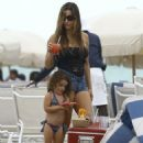 Aaron Diaz and Lola Ponce Enjoy a Day on the Beach in Miami - 454 x 597