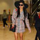 Nicole Scherzinger – Seen at Sydney International Airport in Australia - 454 x 681