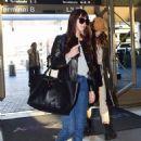 Dakota Johnson – Catch a flight out of LA in Los Angeles