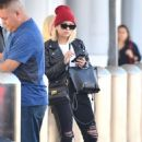 Ashley Benson – Waiting for her car at the LAX airport in Los Angeles