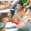 Sun worshipping at its best: Bronzed and sculpted Cristiano Ronaldo reveals his rippling torso as he soaks up the rays at the poolside in Miami