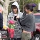 Justin Bieber and his girlfriend Selena Gomez out grocery shopping with some family members in Encino, CA on January 14, 2012