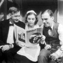 Slim Summerville, ZaSu Pitts and Pat O´Brien check out the latest issue of the Argentinian magazine Cinegraf - 454 x 362
