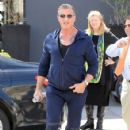 Sylvester Stallone poses with a group of fans while out running errands in Beverly Hills, California on March 28, 2017 - 424 x 600