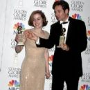 Gillian Anderson and David Duchovny At The 54th Annual Golden Globe Awards (1997) - 410 x 600