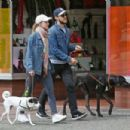 Melissa Benoist and Chris Wood walking her dogs Farley in Vancouver