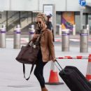 Caroline Flack flees the UK - 454 x 529