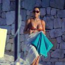 Kim Kardashian in Swimsuit on the beach in Cabo