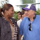 Director GARRY MARSHALL with QUEEN LATIFAH on the set of New Line Cinema's romantic comedy 'Valentine's Day,' a Warner Bros. Pictures release. Photo by Ron Batzdorff - 454 x 307