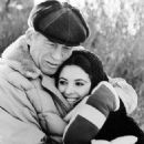 Barbara Parkins gets a hug from John Huston, director of