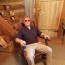 William S. Tribell sitting in Johnny Cash's Chair - 454 x 605