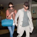 Jason Statham and Rosie Huntington Whiteley arrive at LAX (Los Angeles International Airport) hand in hand