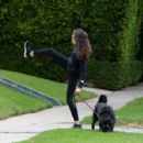 Troian Bellisario – Out for a walk with her dog in Los Angeles - 454 x 428