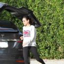 Mila Kunis – Wearing a Sweater and Tights in Los Angeles