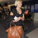 Malin Akerman departing on a flight at LAX airport in Los Angeles, California on January 26, 2015 - 388 x 600