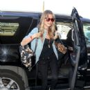 Behati Prinsloo is seen taking a flight at LAX