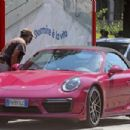 Michelle Hunziker – Spotted at her pink porsche in Milan - 454 x 303