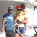 Cristiano Ronaldo holds onto his son Cristiano Jr. while vacationing on a yacht with his family on Tuesday (July 3) in Saint-Tropez, France
