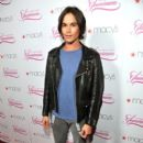 Tyler Blackburn from Pretty Little Liars attended Macy's Passport Presents Glamorama 2011 tonight, September 23, in Los Angeles