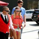 Ashley Tisdale was spotted out with boyfriend Scott Speer today, April 21, in Los Angeles