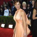 Debbie Dunning - Debbe Dunning In A Peach Gown