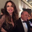 Mick Jagger's former flame Luciana Gimenez steals the show in a plunging mesh gown as she arrives at amfAR Sao Paulo Gala with rocker's lookalike son Lucas, 17 - 454 x 454