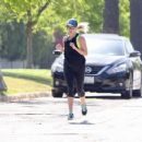 Reese Witherspoon in Tights out jogging in Los Angeles - 454 x 357