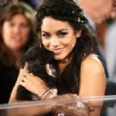 Vanessa Hudgens visits with adoptable puppies from The Shelter Pet Project during the 2015 MTV Video Music Awards at Microsoft Theater on August 30, 2015 in Los Angeles, California