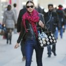 Miranda Kerr steps out with a patterned Prada bag in Midtown, New York City
