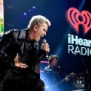 Recording artist Billy Idol performs onstage during the first ever iHeart80s Party at The Forum on February 20, 2016 in Inglewood, California. - 454 x 319