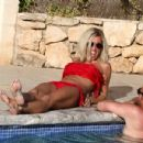 Jenny Frost spending a day - poolside in Ibiza, 08.01.2011 - 454 x 349