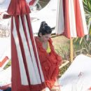 Dua Lipa – Wearing yellow bikini in Miami - 454 x 743