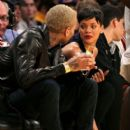 Chris Brown and Rihanna at the New York Knicks and Los Angeles Lakers at Staples Center on December 25, 2012 in Los Angeles