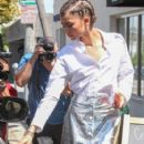 Zendaya heads to her car in West Hollywood, California on April 20, 2016. Zendaya was attending the 'Glamour' lunch at Au Fudge