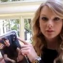 taylor pointing at a joe jonas doll telling us that even the doll comes with a phone so that he could break up with other girls