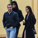 Cristiano Ronaldo puts on a smitten display with stunning new girlfriend Georgina Rodriguez as he goes incognito at Disneyland Paris in a bizarre wig