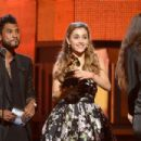 Miguel and Ariana Grande speak onstage during the 56th GRAMMY Awards at Staples Center on January 26, 2014 in Los Angeles, California