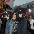 Slash and Meegan Hodges attend Halloween Horror Nights 2018 at Universal Studios Hollywood on September 14, 2018 in Los Angeles, California - 454 x 297