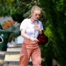 Dakota Fanning – Stops by a friend's house in Hollywood