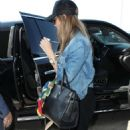 Jessica Alba at LAX Airport in LA - 454 x 681