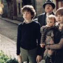 Klaus (Liam Aiken), Sunny (Kara Hoffman/Shelby Hoffman), and Violet (Emily Browning) in Paramount Pictures' Lemony Snicket's A Series of Unfortunate Events, also starring Jim Carrey and Meryl Streep.